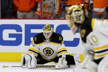 Goalie Jonas Gustavsson (#50) of the Boston Bruins stretches during the warm-ups