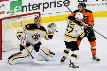 Goalie Tuukka Rask (#40) of the Boston Bruins gloves a puck in the second period