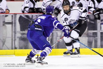 Becca King (BRA - 2) looks to skate the puck past Sena Suzuki (TOR - 6).