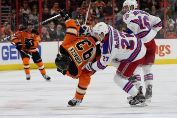 Defenseman Ryan McDonagh (#27) of the New York Rangers and Right Wing Jakub Voracek (#93) of the Philadelphia Flyers collide into each other during the first period