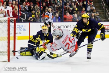 Brendon Kearney (OSU - 25) channels Bobby Orr as he scores a goal against Steve Racine (UM - 1).