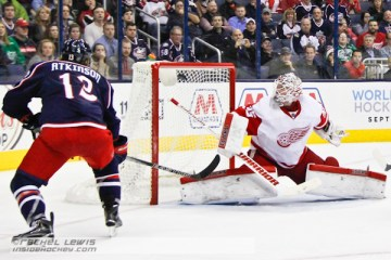 Cam Atkinson (CBJ - 13) scores a goal against Jimmy Howard (DET - 35).