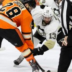 Center Nick Bonino (#13) of the Pittsburgh Penguins takes a face-off against Center Claude Giroux (#28) of the Philadelphia Flyers during the second period