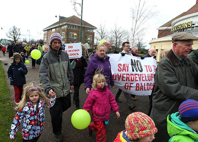'Say no to overdevelopment,' reads one banner