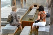 Locals enjoying a dip in the foot spa at Kami no Yu Bathhouse, Togatta.