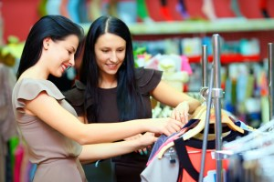 Two women shopping together for clothes.
