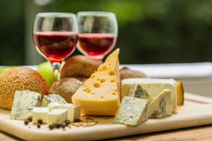 Aged cheese and wine have been known to cause headaches and migraines if consumed while sick.