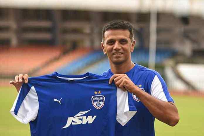 Rahul Dravid posing with Bengaluru FC team Jersey