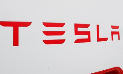 Tesla says cars can automatically stop for traffic lights
