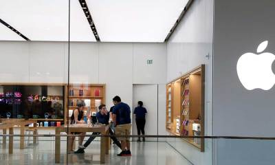 Apple re-closes some stores, raising economic concerns