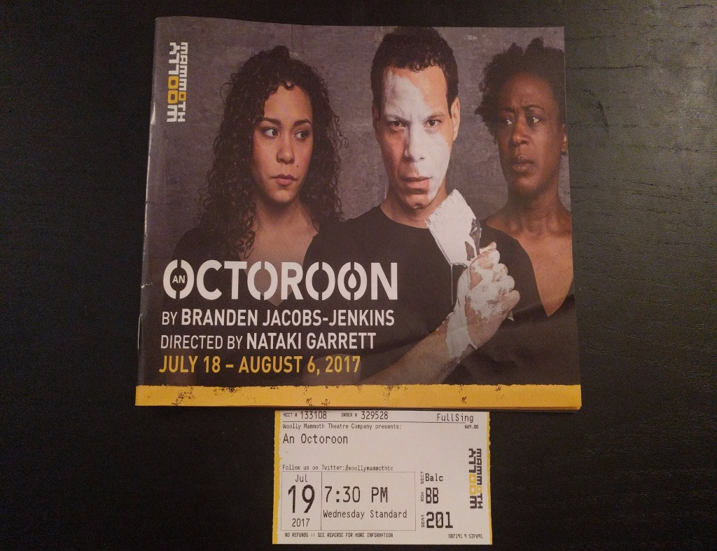 "The cover of the program for ""An Octoroon"" by Branden Jacobs-Jenkins. Two African American women on either side of an African American man who has a paint brush in his hand with white paint on it, which has just put a streak down his face. The ticket for the performance is below the program."