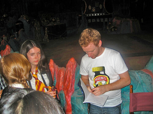 Chris Rankin (Percy Weasley) signs an autograph
