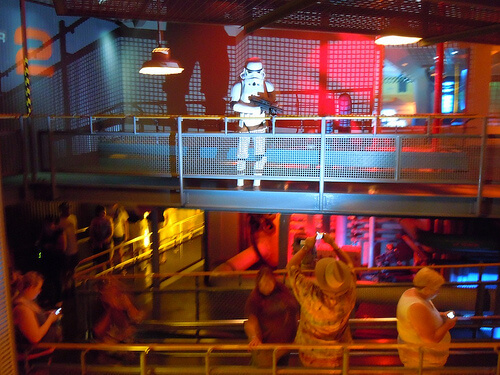 Stormtrooper keeps guests in order in the Star Tours queue