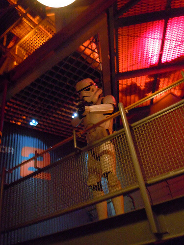 Stormtrooper aims at guests in the Star Tours queue