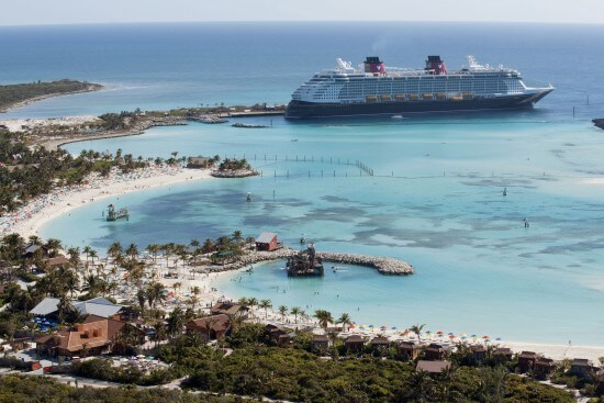 The Disney Dream docks at Castaway Cay, Disney's private island in the tropical waters of the Bahamas, reserved exclusively for Disney Cruise Line guests. In a setting of crystal-clear turquoise waters, powdery white-sand beaches and lush landscapes, the 1,000-acre island offers one-of-a-kind areas and activities for every member of the family. (David Roark, photographer)