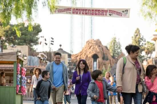 Families with Boysenberry Festival Banner with Log Ride
