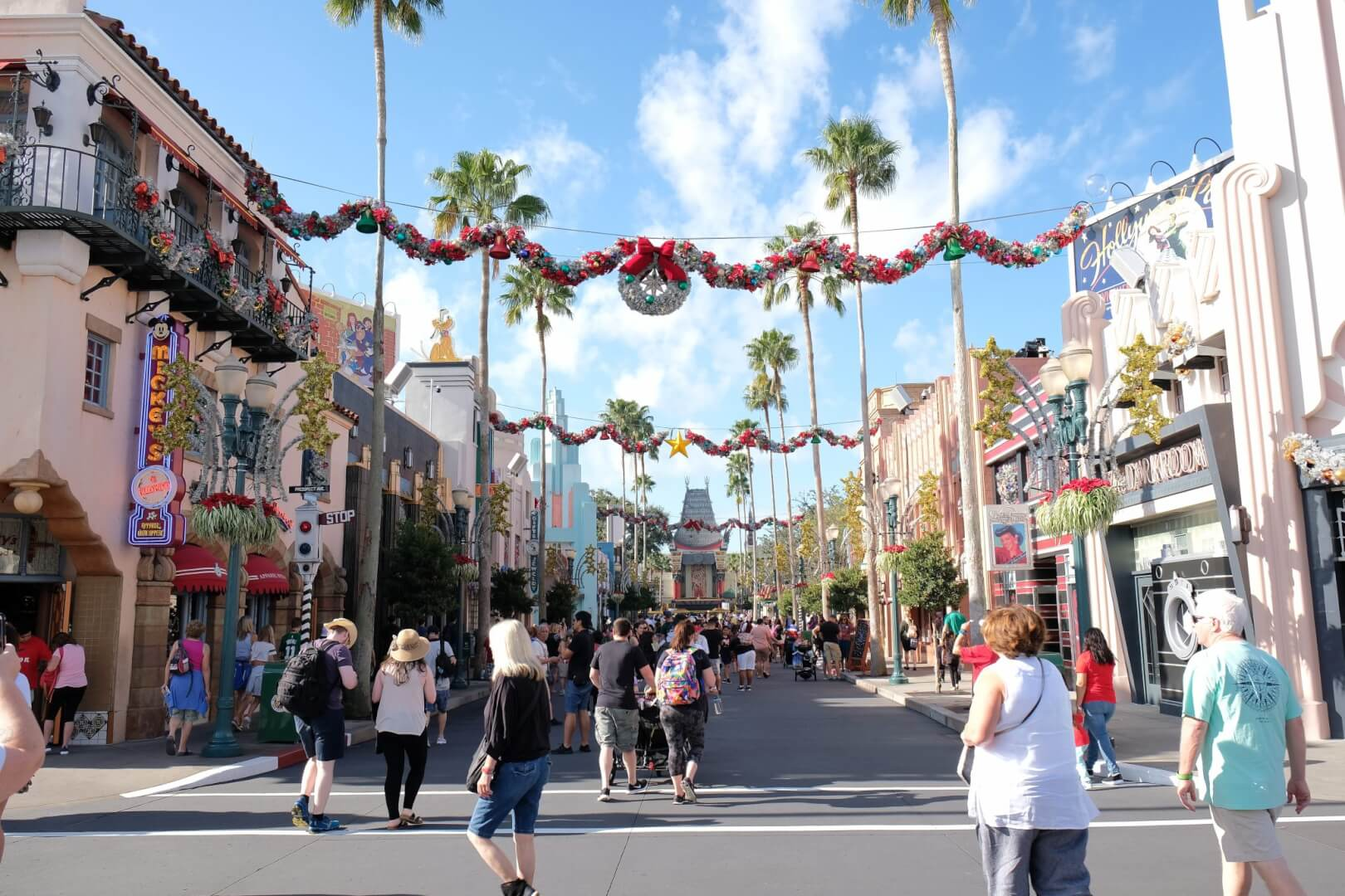 the decorations completely take over hollywood boulevard which contains wreaths decorative balls tinsel christmas trees garland and other adornments to - When Does Disney World Decorate For Christmas 2017