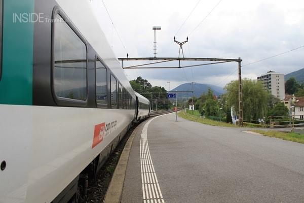 Train curving into the smoke