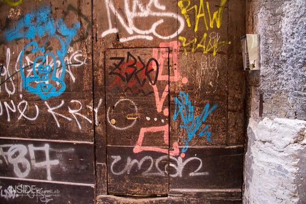 Graffiti covered door in Naples