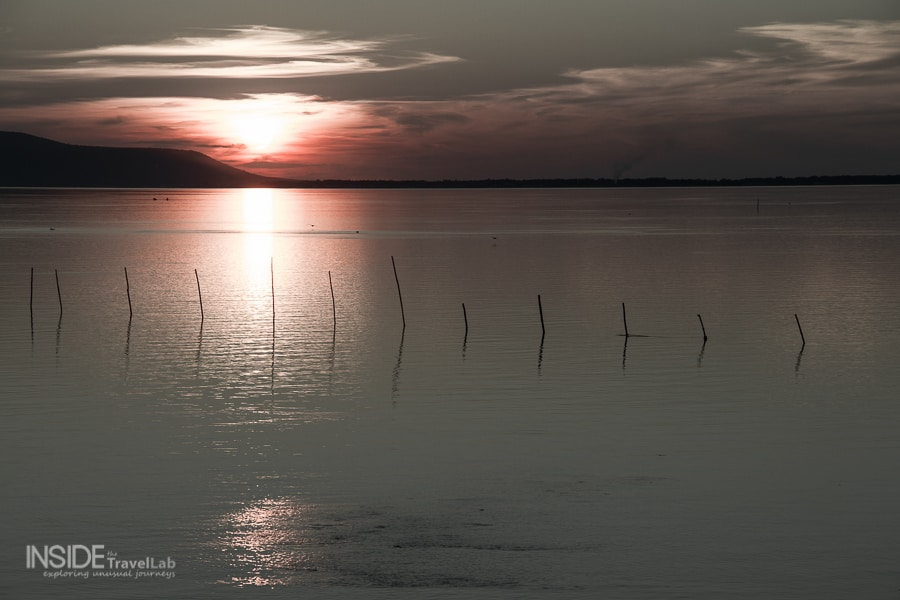 Pink and grey sunset on Lake Varano, Puglia, Italy