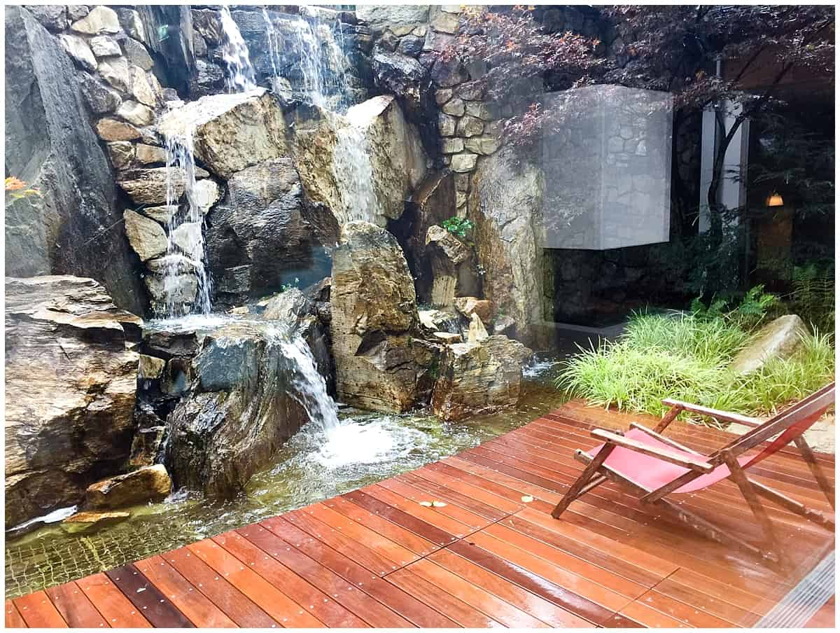 Gazing at the waterfall from the Kitzhof Mountain Resort Spa