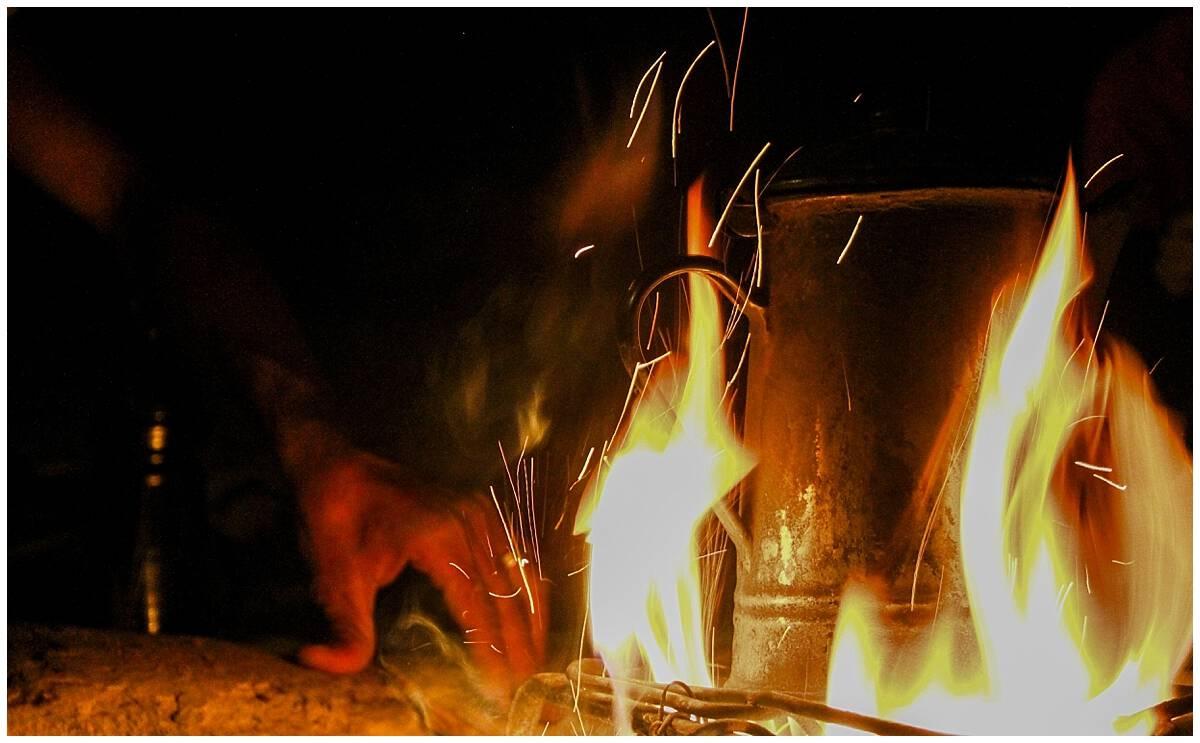 Preparing Arabic coffee in the desert around a fire in Jordan at Feynan Ecolodge Dana Nature Reserve