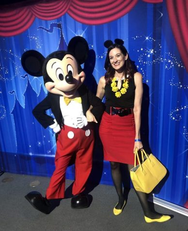 Theresa DisneyBounding as Mickey Mouse while posing next to him.