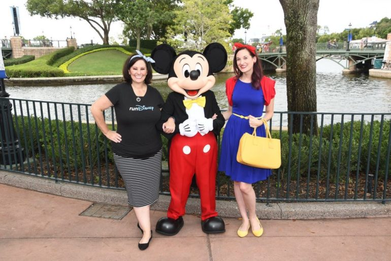 Theresa and Patty posing with Mickey Mouse in the middle
