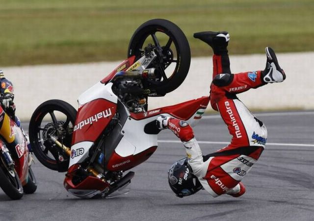 Mahindra Moto3 rider Oliveira of Portugal crashes during the Australian Motorcycling Grand Prix Moto3 race at Phillip Island Circuit