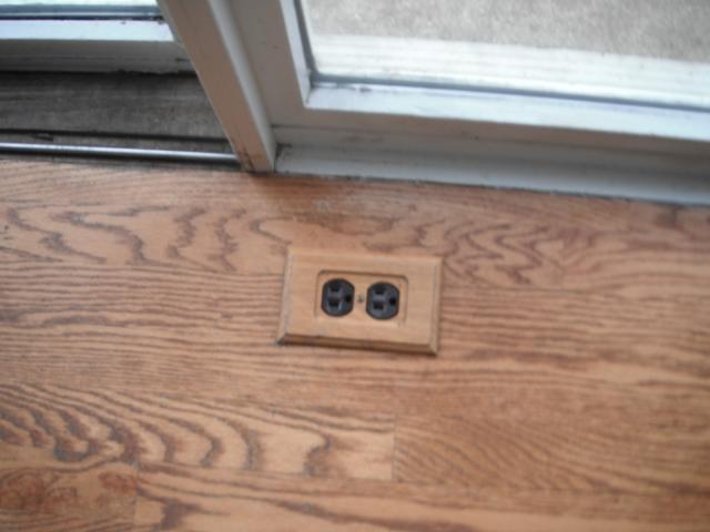 Improper and unsafe electrical floor outlet Oak Forest