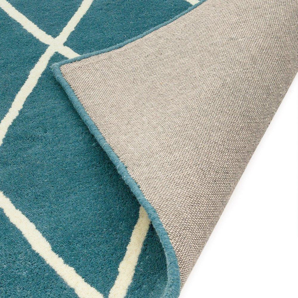 tapis de luxe design bleu turquoise en laine par joseph lebon