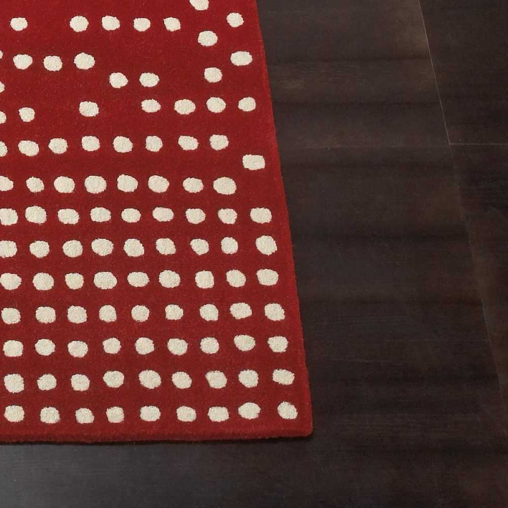 tapis de luxe design rouge et blanc casse pompons cascata par carving