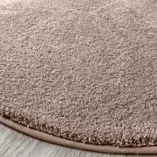 tapis rond beige ou taupe des