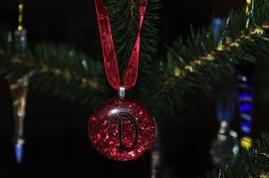 Red Glitter Gem Ornament with Letter hanging on Tree
