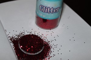 Red Glitter added to back of clear glass gem