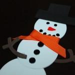 attach brown foam arms to snowman