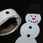 add 7mm black rhinestones to snowman magnet