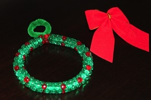 Beaded wreath ornament ready for red velvet bow