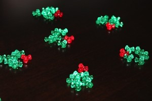 Piles of green and red tri beads for wreath ornaments