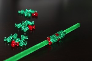string green and red tri beads on chenille stems for wreaths