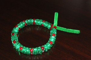twist the top of chenille stem to make the beaded wreath
