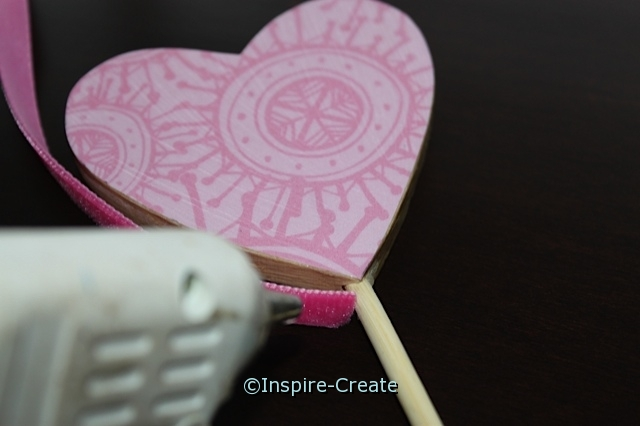 attach velvet ribbon to the side of wooden heart