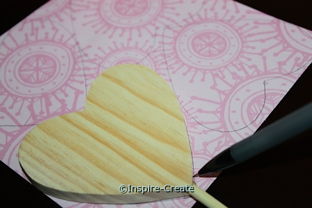 trace wood hearts onto scrapbook paper