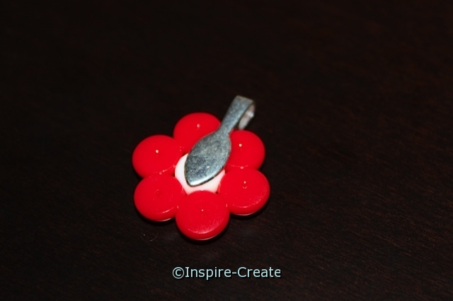 attach jewelry bail to back of melted pony bead flower for necklace