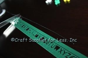 Cut black elastic for bracelet