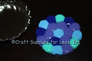 Melted Pony Beads removed from bottle cap