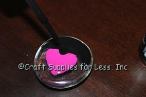 Paint black polish over design on gem
