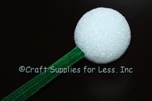 Green chenille stems added to styrofoam ball