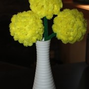 Yellow Bump Chenille Flowers in a white vase
