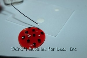 using paperclip to make small white dots on gem